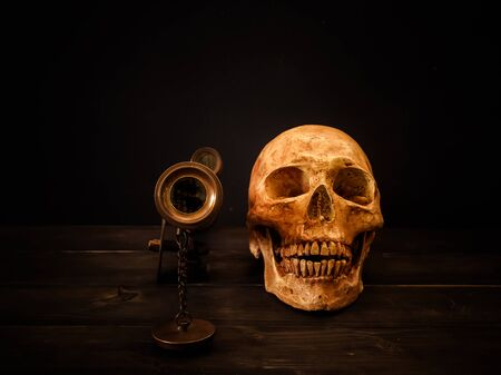 Still life with human skull and vintage binocular Stock Photo