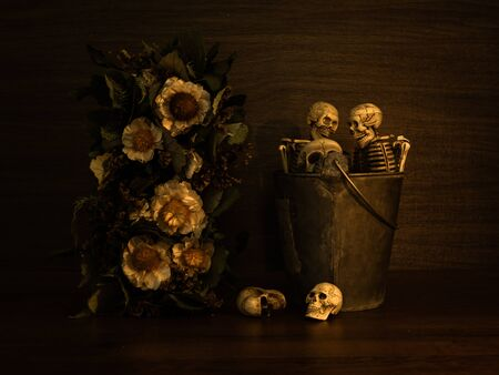 Still life with human skull and dry flowers, Vintage style