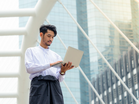 Young Burmese businessman find data in laptop ,It's time to talk about business Stok Fotoğraf