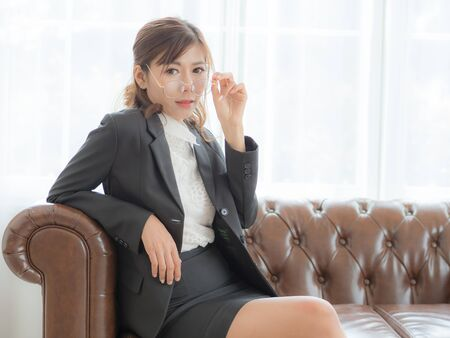 Asian business women sit back and relax on the sofa after working during a break in a highly competitive business