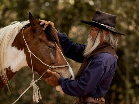 Cowboy touches the horse with love Because of relationships that are friends who share suffering and happiness together