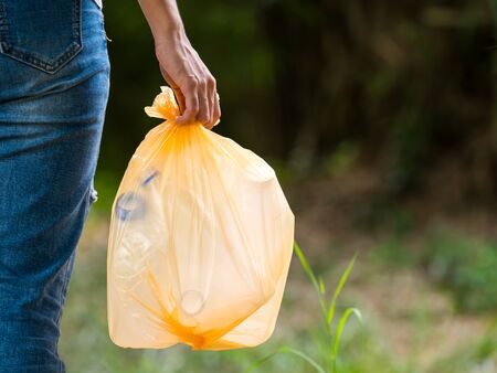 Volunteer women carry plastic bags in plastic bottles collected in public parks, From people who refuse to dump in the trash