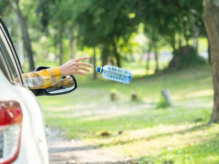 The woman threw a plastic water bottle after drinking all the water into the park area, By not allowing to throw in the trash