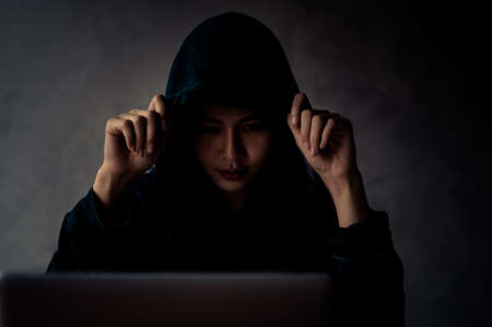 Young Asian hackers find personal information on the internet and use it to make money illegally