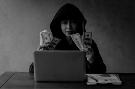 Young Asian hackers are searching for information on the internet and using it illegally Фото со стока
