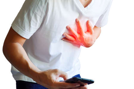 single young man walks with a cell phone 911 to make an emergency call, at risk of heart attack.