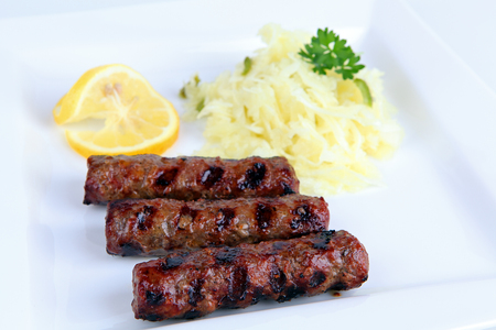 cole: grilled cevapcici with cole slaw