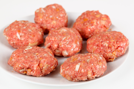 mincing: raw meatballs Stock Photo