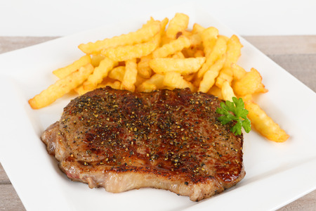 rumpsteak: grilled rumpsteak with fries on a plate Stock Photo