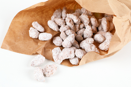 white roasted almonds in a paper bag