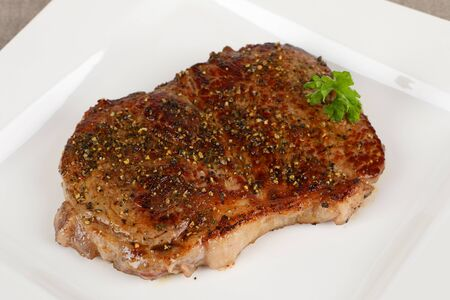 grilled rumpsteak on a plate Stock Photo