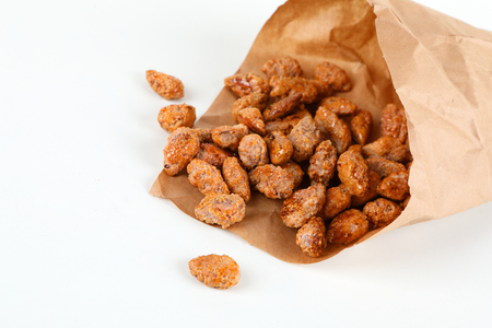 brown roasted almonds in a paper bag