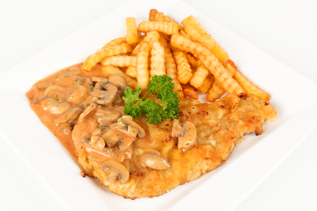 breadcrumbs: escalope with mushrooms and french fries on a plate