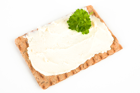 crispbread with cream cheese and white background