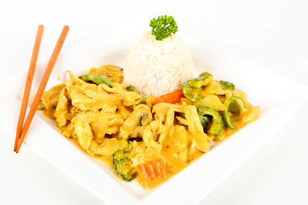 asian chicken with curry on a plate