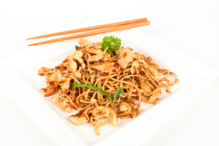 Asian rice with chicken on a plate Stock Photo