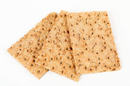 crispbread with sesame and white background Stock Photo