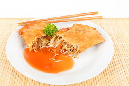 bean sprouts: fried asian spring roll on a plate