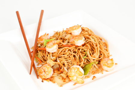 bean sprouts: asian noodles with shrimps on a plate
