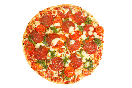 A Pizza with pesto and tomatoes
