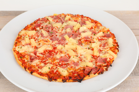 a backed pizza with pinapple and ham Stock Photo