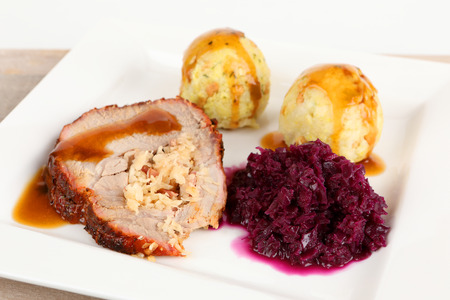 rolled roast with dumplings and red cabbage