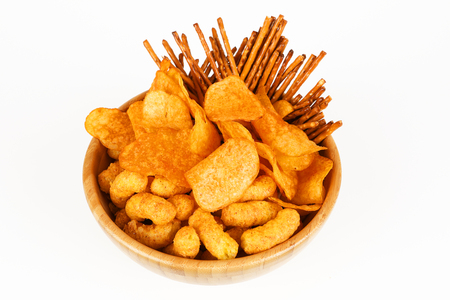 different salty snacks in a bowl and white background Stock Photo