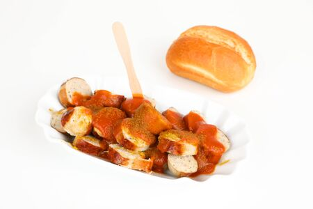 sliced sausage with curry sauce and a roll Stok Fotoğraf