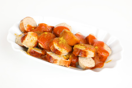 a sliced sausage with curry sauce