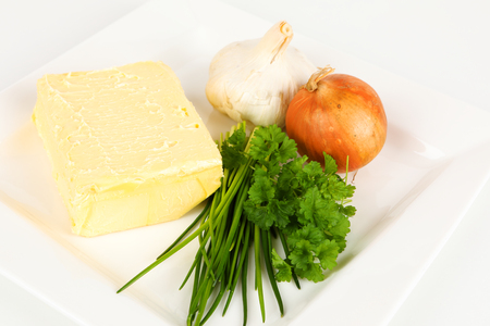 Ingredients for a herb butter on a plate