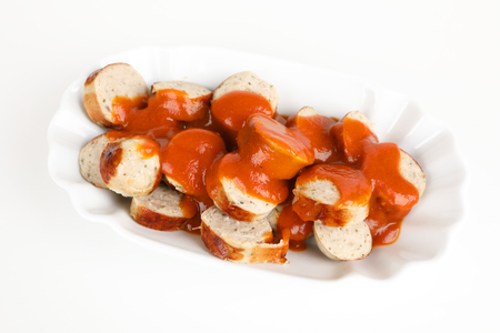 a sliced sausage with sauce