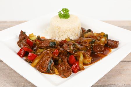 asian beef with teriyaki sauce on a plate Stok Fotoğraf