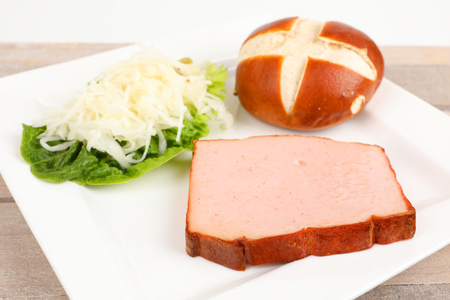 baked meat loaf with coleslaw on a plate