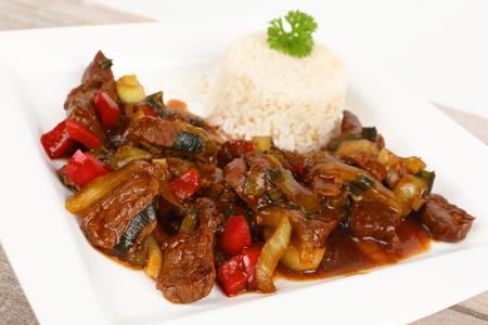 asian beef with teriyaki sauce on a plate Stok Fotoğraf - 97321448