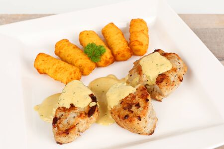 pork fillet with potato croquettes and mustard sauce Stok Fotoğraf - 97375730