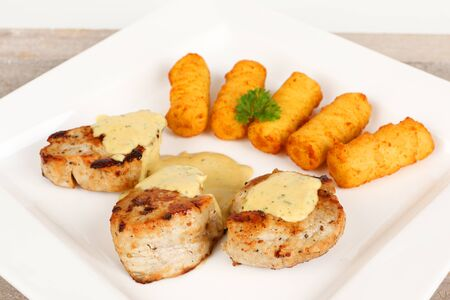 pork fillet with potato croquettes and mustard sauce