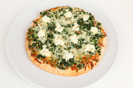 pizza with spinach and ricotta on a plate
