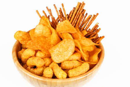 different salty snacks in a bowl and white background Stok Fotoğraf - 97403826