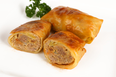 A cabbage roulade filled with minced meat Stok Fotoğraf - 97403840