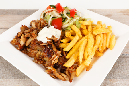 Chicken doner on a plate with fries and salad Stok Fotoğraf - 97403843