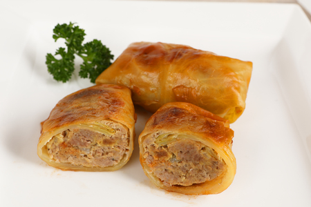 A cabbage roulade filled with minced meat Stok Fotoğraf - 97403844