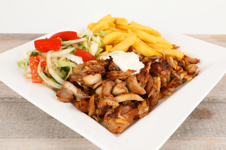 Chicken doner on a plate with fries and salad Stok Fotoğraf - 97403847
