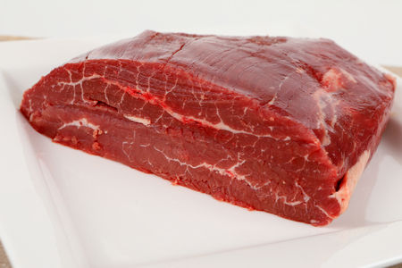 a piece of raw dry aged flank steak