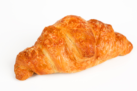 Croissant filled with ham and cheese on white background