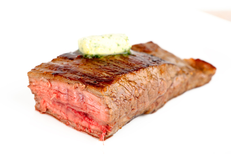 grilled dry aged flank steak on a plate