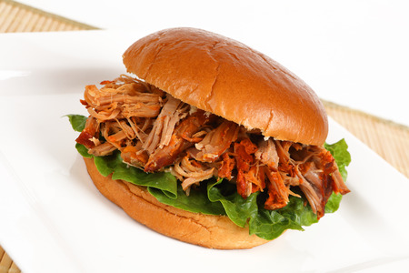 A burger with pulled pork on a plate