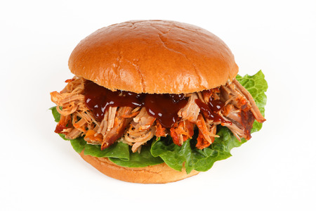 A burger with pulled pork and white background