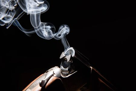 sports shell: Smoke from a hunting rifle after firing