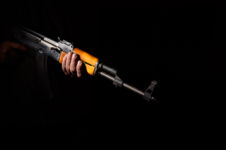 assault rifle close-up in the dark