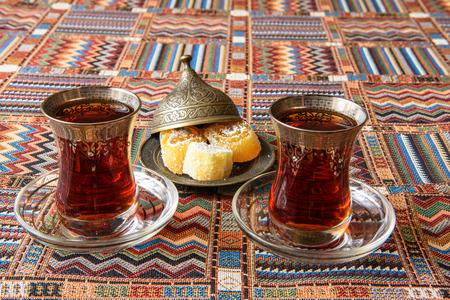 baklava: Traditional Turkish tea on the colored tablecloth Stock Photo
